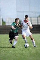Two Pro Soccer Players Competing For Ball