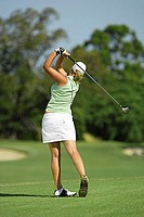 Female Golfer Making a Tee Shot