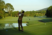 Male Golfer Making a Tee Shot