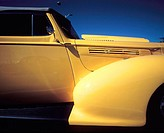 Yellow fender of hot rod car