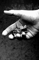 Black and white picture of hand holding two dices