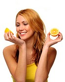 A woman holding half an orange on her right hand and another half on her left hand