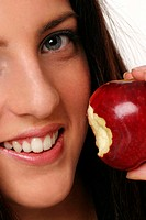 A woman posing with a bitten red apple