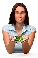 A woman holding up a plate of sliced cucumbers