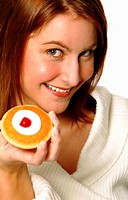 A woman showing a pastry to the camera