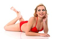 A woman in red bikini lying down on the floor