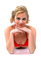 A woman in red bra top resting her chin on her hands