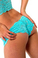 A back view picture of a woman in blue lingerie
