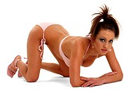 A woman in pink bikini crouching down on the floor