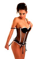 A woman in sensual corset looking down