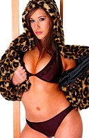 A woman in purple bikini and a hooded leopard skin jacket opening one side of her jacket