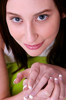An up-close picture of a woman with nice and clean fingernails