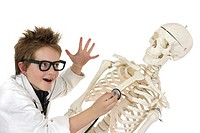 A boy disguising as a doctor putting a stethoscope to a skeleton