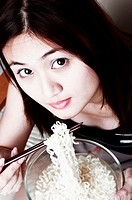 Woman eating instant noodles