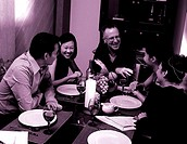 Men and women having dinner (thumbnail)
