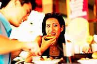 Woman eating pizza (thumbnail)