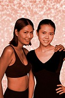 Two women in exercising attire posing for the camera