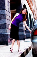 Woman opening the car door