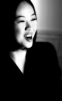 Black and white picture of a business woman laughing