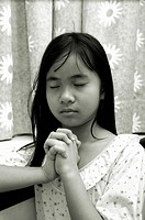 Girl saying prayers before sleep