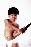 Boy playing with a toy knife