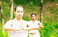 Man and woman practising yoga