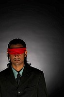 Blindfolded businessman.