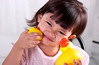 Girl playing with rubber duck (thumbnail)