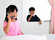 Children talking on the phone