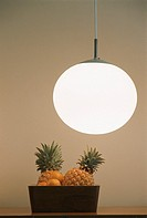 Bowl of fruit and a globe hanging lamp