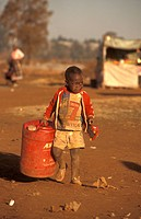 Boy-carrying-Water,-Tembisa,-East-Rand,-Gauteng,-South-Africa