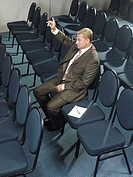 Businessman listening to presentation (thumbnail)