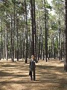Businesswoman stood in forest