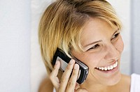 Woman using cellular telephone