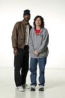 Two men in casual clothing standing in studio