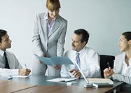 Businesswoman showing file in meeting