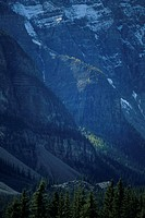 Barren mountain faces partially covered with snow at dusk, Canadian Rockies, Alberta, Canada