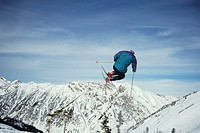 Skier in mid-air, Snowbird, Utah, USA