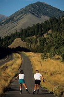 Couple in-line skating on country road, Sun Valley, Idaho, USA