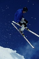 Skier jumping in mid-air, low angle view