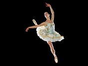 Young female ballerina jumping in midair, portrait