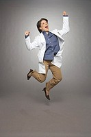 Female doctor jumping and shouting
