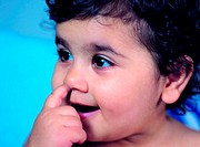 Toddler with finger in her nose