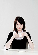 Businesswoman holding a cup of coffee.