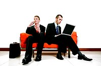 Businessmen talking on the cellphone and using laptop