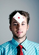 Businessman with a playing card on his forehead