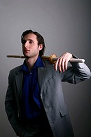 Businessman posing with a sword.