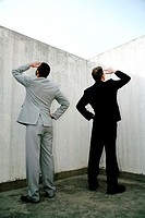 Businessmen searching for something