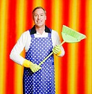 Man in apron holding a broom