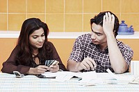 Close-up of a young couple looking at credit cards
